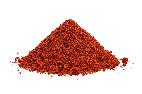 Pile of red powder, isolated on white background