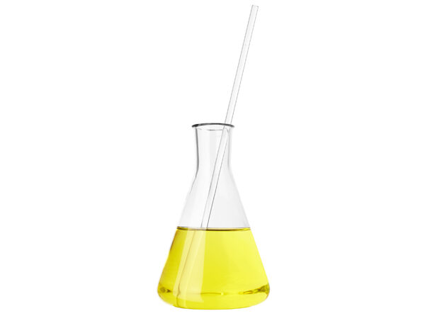 frontal view of different types of glass containers used in the laboratory, filled with transparent colorless liquid and one empty, with a bright yellow background