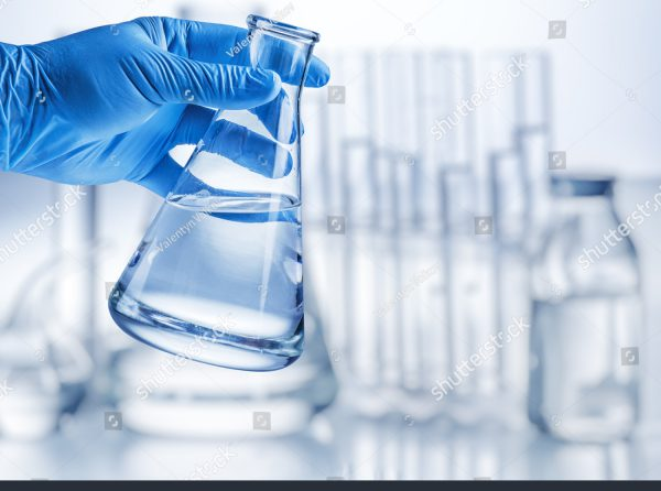 stock-photo-laboratory-beaker-in-analyst-s-hand-in-plastic-glove-570636712